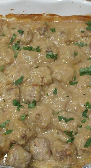 A baking dish full of ground turkey in a creamy gravy.