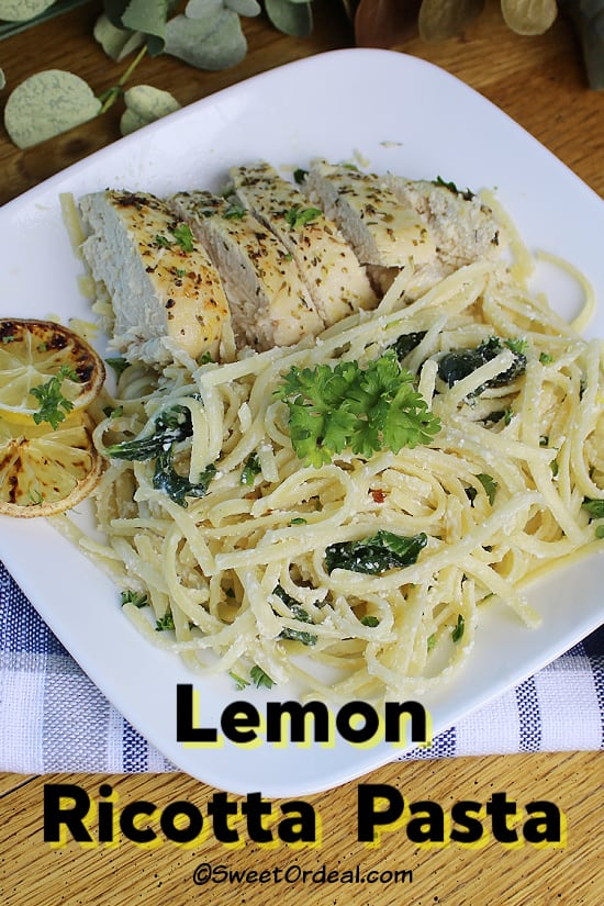 A plate of linguine and sliced baked chicken.