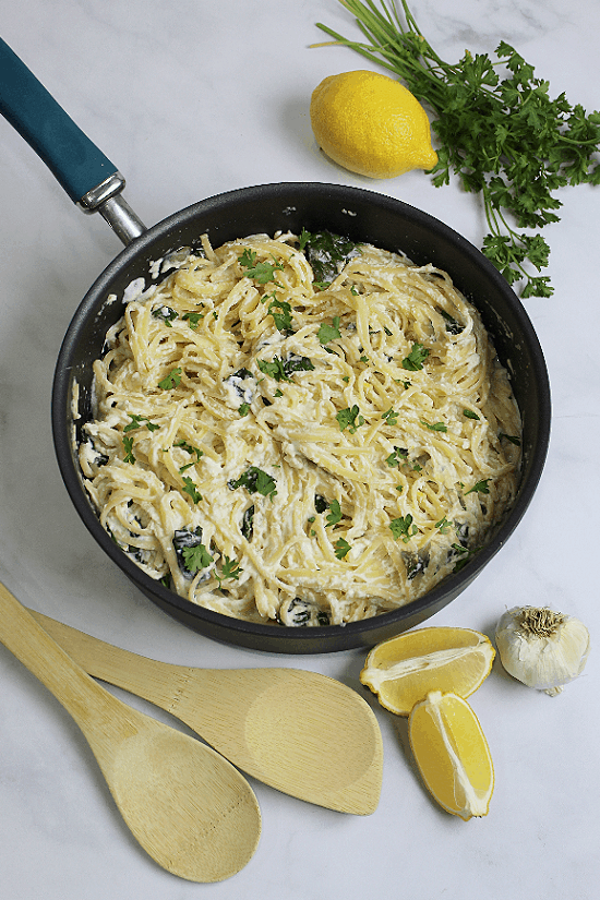 A pan of cooked linguine in a lemon cheese sauce.