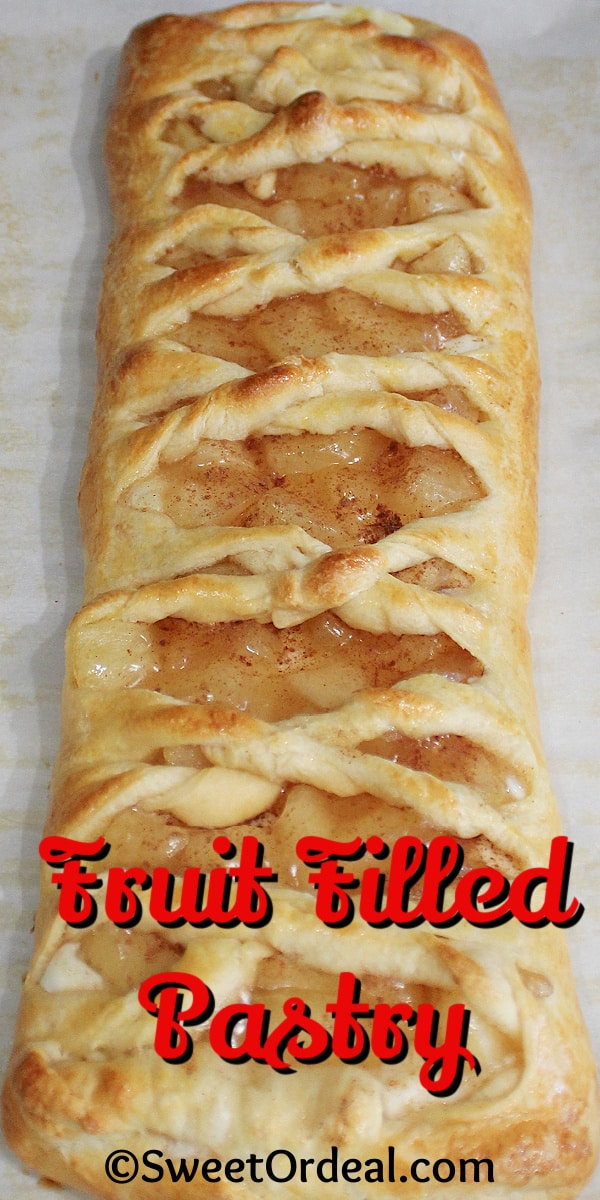 A flat braided dessert with criss-crossed dough.