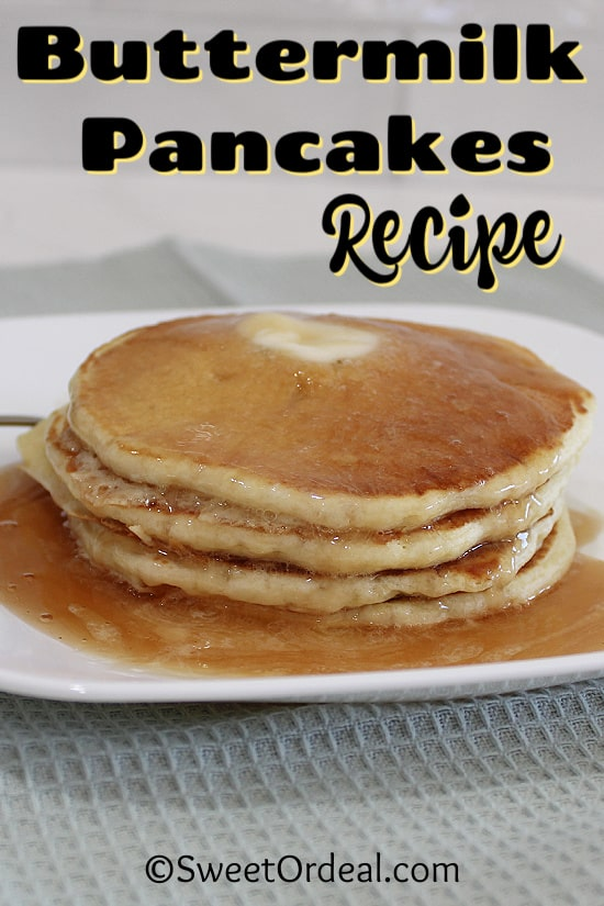 Stacked pancakes with butter and syrup.