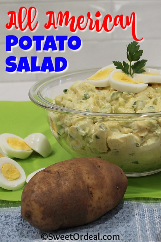Clear bowl of potato salad with whole potato and sliced hard boiled eggs.
