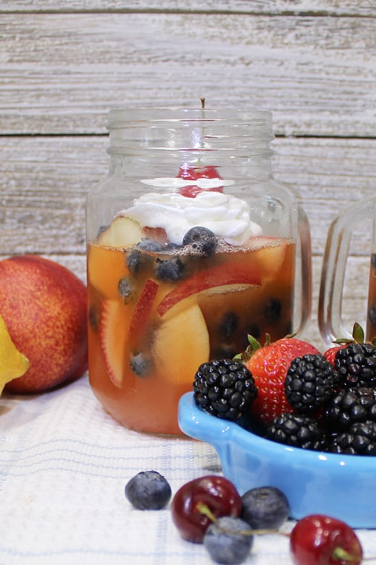 Fresh fruits of summer served in a glass with gelatin.