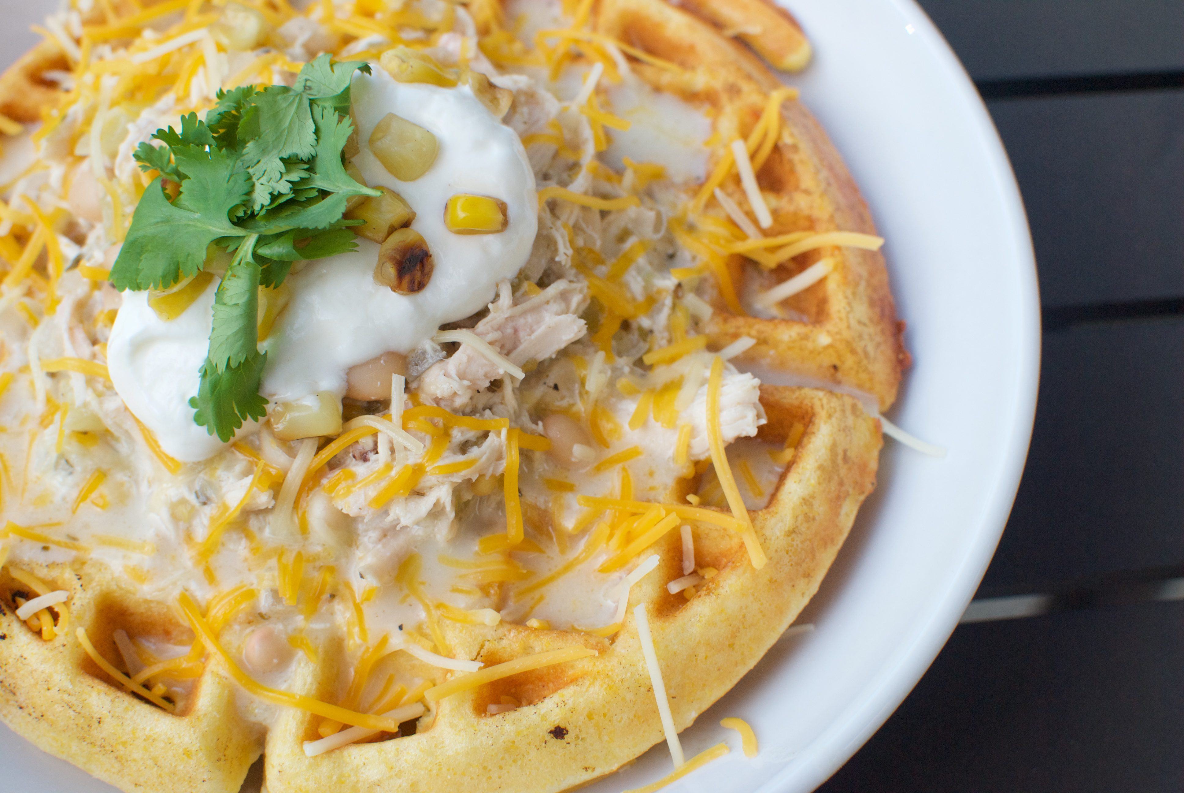 white bean chicken chili over cornbread waffles is a fun and festive soup any night of the week!