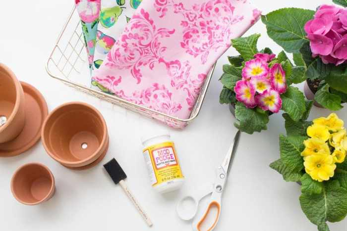 Create Gorgeous Fabric Covered Clay Flower Planters for Spring using Mod Podge