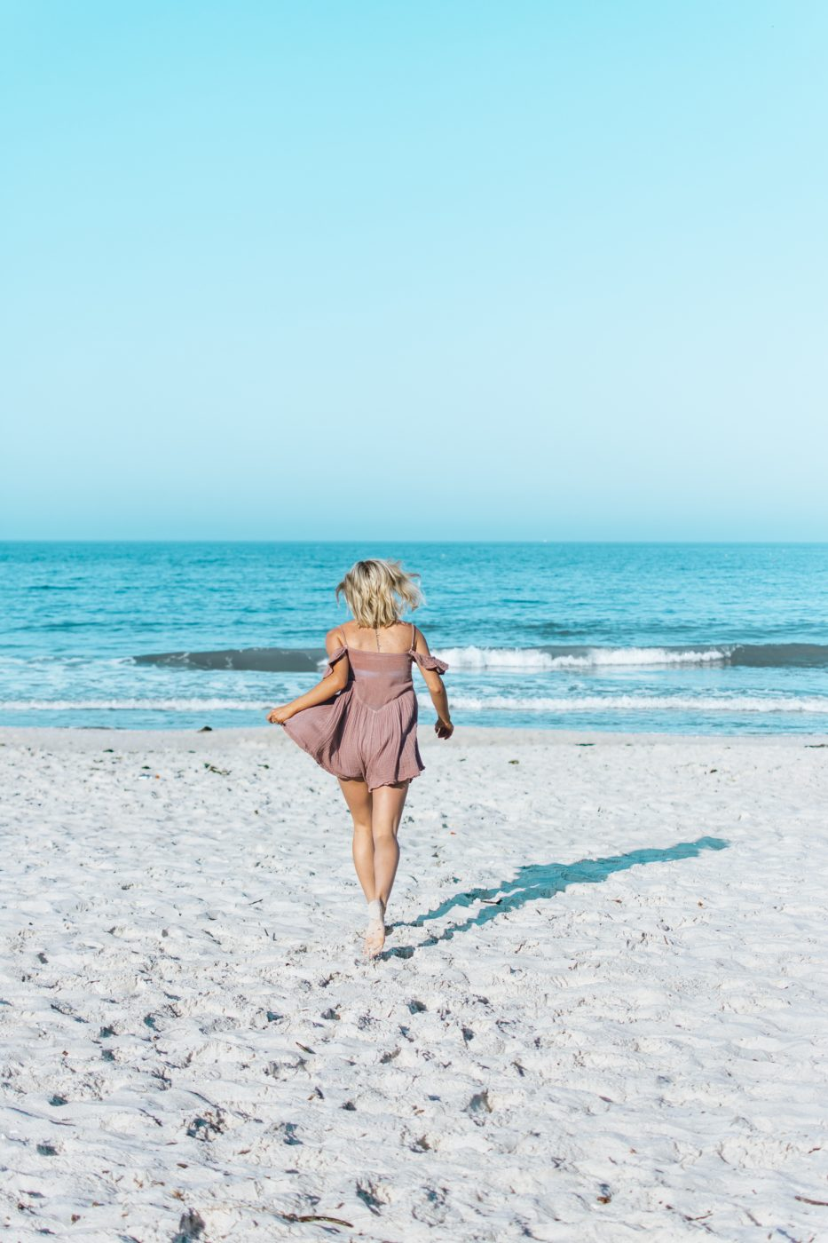 Jenny of Sweet Teal running on beach