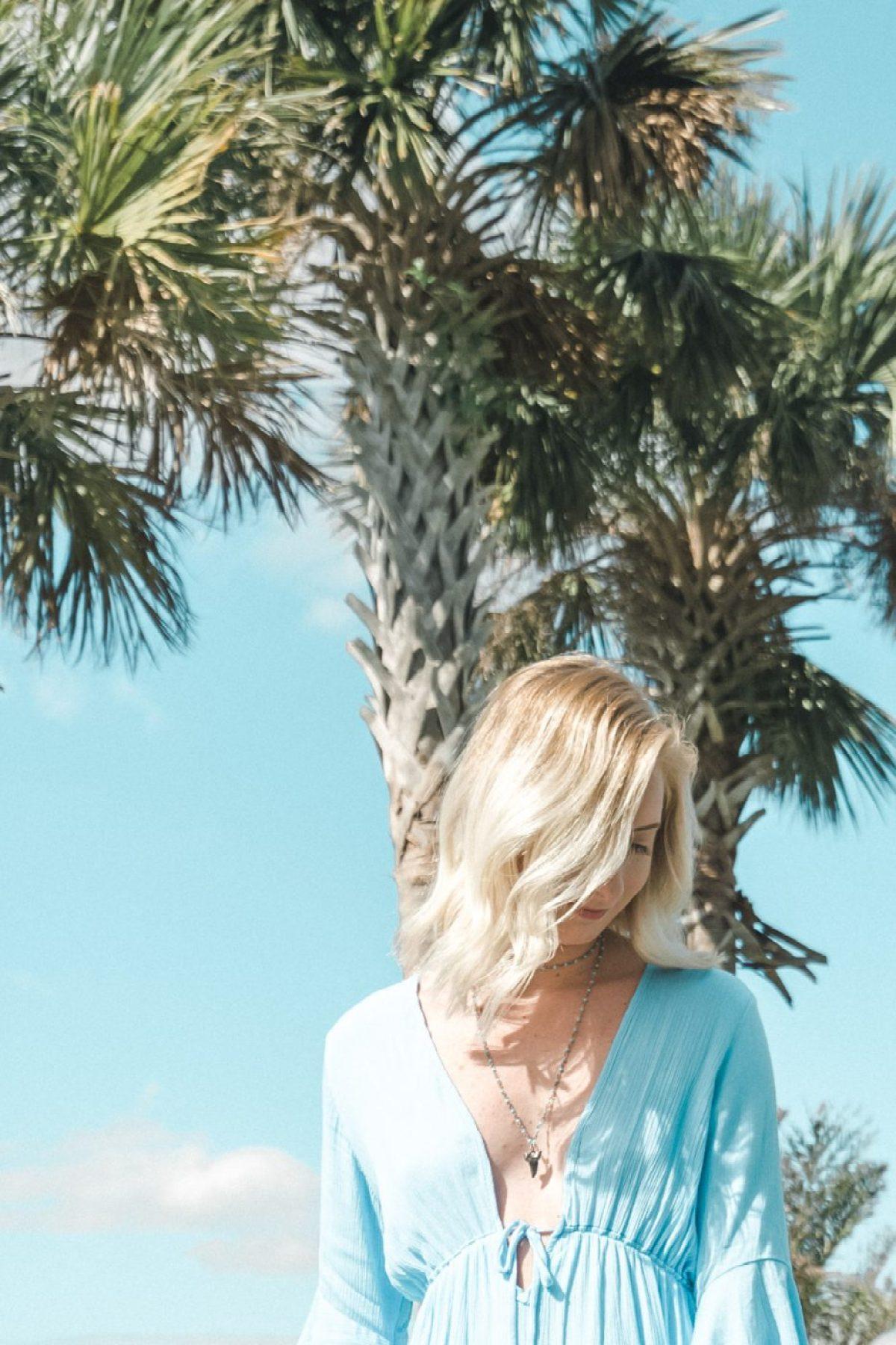 Jenny wearing a low cut blue top