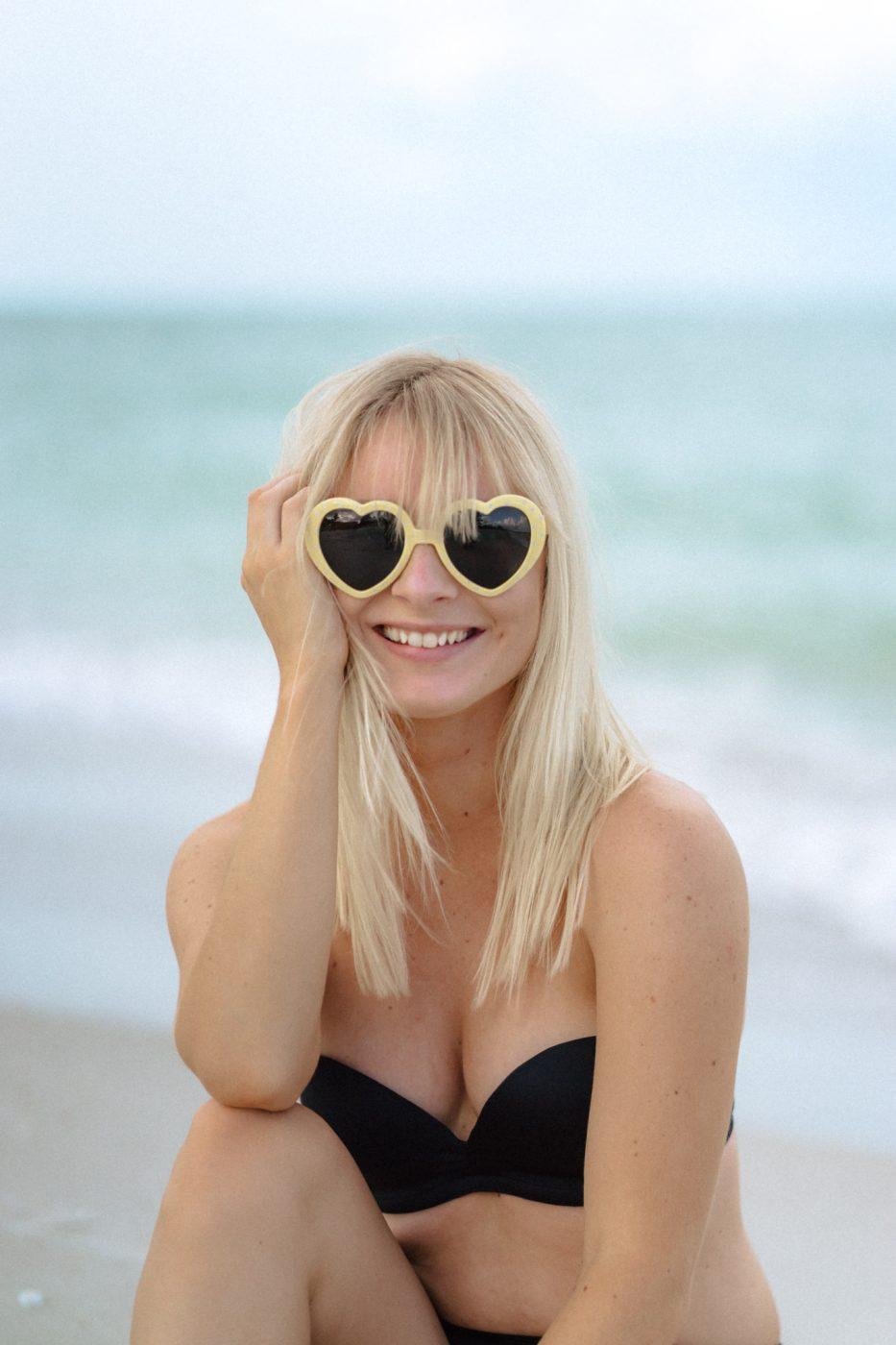 Jenny wearing heart sunglasses
