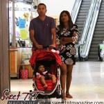 East Indian family with stroller spend wisely at Trincity Mall in sweet T&T for Sweet TnT Magazine, Culturama Publishing Company, for news in Trinidad, in Port of Spain, Trinidad and Tobago, with positive how to photography.