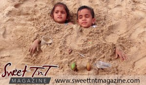 Children playing in the sand at Granville Beach in sweet T&T for Sweet TnT Magazine, Culturama Publishing Company, for news in Trinidad, in Port of Spain, Trinidad and Tobago, with positive how to photography.