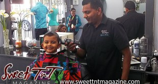 Barber Faisal Mohammed, Master of Fades trims smiling boy in salon, Sweet T&T, Sweet TnT, Trinidad and Tobago, Trini, vacation, travel