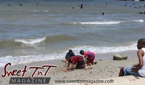Three boys dig hole in sand on Chaguaramas Beach in Sweet T&T, Sweet TnT Magazine, Trinidad and Tobago, Trini, vacation, travel Chaguaramas Boardwalk