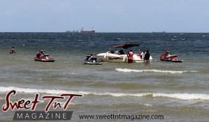 3 jet skis, men, boat in sea water at Chaguaramas Beach in Sweet T&T, Sweet TnT Magazine, Trinidad and Tobago, Trini, vacation, travel Chaguaramas Boardwalk