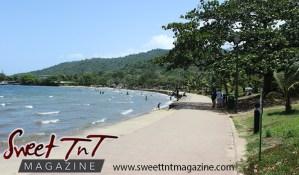 Blue sky, mountains, waves in sea, trees, shoreline at Chaguaramas Beach in Sweet T&T, Sweet TnT Magazine, Trinidad and Tobago, Trini, vacation, travel Chaguaramas Boardwalk