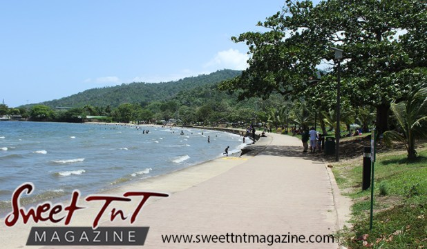 Blue sky, mountains, waves in sea, trees, shoreline at Chaguaramas Beach in Sweet T&T, Sweet TnT Magazine, Trinidad and Tobago, Trini, vacation, travel Chaguaramas Boardwalk