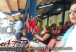 Cricket stand with tourists, spectators, man selling national flags red black and white at Queen's Park Oval, Cricket Club, West Indies Cricket board office by Nadia Ali in Sweet T&T, Sweet TnT Magazine, Trinidad and Tobago, Trini, vacation, travel