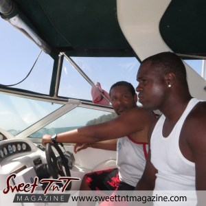 Captain and man in white vest cruising down de islands by Nadia Ali in Sweet T&T, Sweet TnT Magazine, Trinidad and Tobago, Trini, vacation, travel