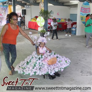 Girl in pink flower dress on wheelchair at special needs children Easter Bonnet parade at Queen's Park Cricket Club, color eggs, Sweet T&T, Sweet TnT, Trinidad and Tobago, Trini, vacation, travel
