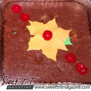 Fruit cake, with cherries and yellow flower on a plate by Radha Ramoutar, Sweet T&T, Sweet TnT, Trinidad and Tobago, Trini, vacation, travel
