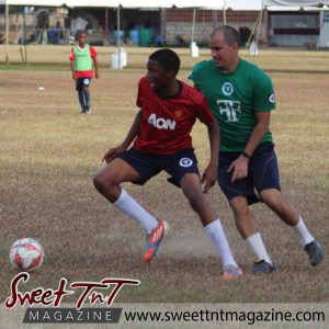 Coach and student tackle, Football Factory, St Mary's college, CIC grounds, Terry Fenrick, sports in T&T, Sweet T&T, Sweet TnT, Trinidad and Tobago, Trini, vacation, travel