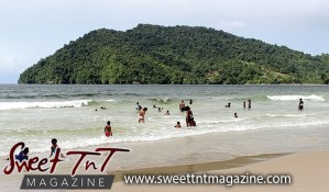 Bathers at Maracas the popular beach, mountain, sand and sea, Caribbean sea, Sweet T&T, Sweet Trinidad and Tobago. Water supply in Trinidad.