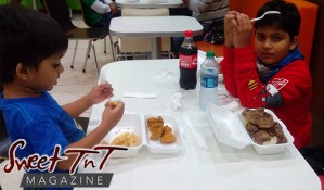 Nerissa Hosein's children Zayn and Eshan at Abraham's eating grilled beef, fries, fried chicken, Dasani water, Coca Cola in Sweet T&T, Sweet TnT Magazine, Trinidad and Tobago, Trini, vacation, travel