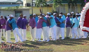 Hosay Muslim men hug, peace offering, brotherly love in Sweet T&T, Sweet TnT, Trinidad and Tobago, Trini, Travel, Vacation, Tourist, Hosay, Muslim, Parade, Tomb, Drummers, Funeral Procession, Woodbrook, St James, St Clair, Palm, Dancing the moon, Tadjahs, Moons, Tadjahs, mosques, Hussein, Hassan, tombs, tassa side, two moons, Husayn, Hassan