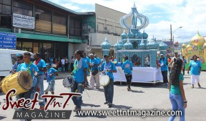 Hosay Muslim men in blue beat drums, push floats in Sweet T&T, Sweet TnT, Trinidad and Tobago, Trini, Travel, Vacation, Tourist, Hosay, Muslim, Parade, Tomb, Drummers, Funeral Procession, Woodbrook, St James, St Clair, Palm, Dancing the moon, Tadjahs, Moons, Tadjahs, mosques, Hussein, Hassan, tombs, tassa side, two moons, Husayn, Hassan