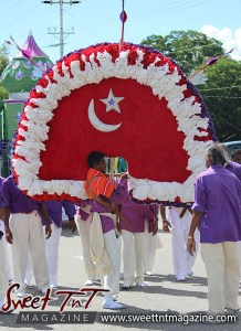 Hosay spinning the tadjah in Sweet T&T, Sweet TnT, Trinidad and Tobago, Trini, Travel, Vacation, Tourist, Hosay, Muslim, Parade, Tomb, Drummers, Funeral Procession, Woodbrook, St James, St Clair, Palm, Dancing the moon, Tadjahs, Moons, Tadjahs, mosques, Hussein, Hassan, tombs, tassa side, two moons, Husayn, Hassan