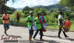 Hosay men beating drums in Sweet T&T, Sweet TnT, Trinidad and Tobago, Trini, Travel, Vacation, Tourist, Hosay, Muslim, Parade, Tomb, Drummers, Funeral Procession, Woodbrook, St James, St Clair, Palm, Dancing the moon, Tadjahs, Moons, Tadjahs, mosques, Hussein, Hassan, tombs, tassa side, two moons, Husayn, Hassan