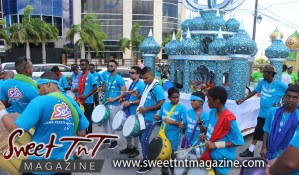 Hosay Muslim boys in blue beat drums in Sweet T&T, Sweet TnT, Trinidad and Tobago, Trini, Travel, Vacation, Tourist, Hosay, Muslim, Parade, Tomb, Drummers, Funeral Procession, Woodbrook, St James, St Clair, Palm, Dancing the moon, Tadjahs, Moons, Tadjahs, mosques, Hussein, Hassan, tombs, tassa side, two moons, Husayn, Hassan