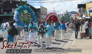 Hosay Muslim men in blue parade in Sweet T&T, Sweet TnT, Trinidad and Tobago, Trini, Travel, Vacation, Tourist, Hosay, Muslim, Parade, Tomb, Drummers, Funeral Procession, Woodbrook, St James, St Clair, Palm, Dancing the moon, Tadjahs, Moons, Tadjahs, mosques, Hussein, Hassan, tombs, tassa side, two moons, Husayn, Hassan