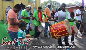Hosay Muslim men in green beat drums in Sweet T&T, Sweet TnT, Trinidad and Tobago, Trini, Travel, Vacation, Tourist, Hosay, Muslim, Parade, Tomb, Drummers, Funeral Procession, Woodbrook, St James, St Clair, Palm, Dancing the moon, Tadjahs, Moons, Tadjahs, mosques, Hussein, Hassan, tombs, tassa side, two moons, Husayn, Hassan