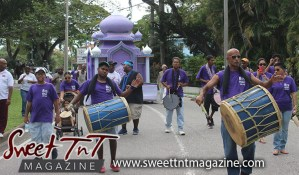 Hosay bald head drummer in Sweet T&T, Sweet TnT, Trinidad and Tobago, Trini, Travel, Vacation, Tourist, Hosay, Muslim, Parade, Tomb, Drummers, Funeral Procession, Woodbrook, St James, St Clair, Palm, Dancing the moon, Tadjahs, Moons, Tadjahs, mosques, Hussein, Hassan, tombs, tassa side, two moons, Husayn, Hassan
