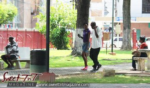 People walking in Woodford Square, sign, 1917, 100 years in 2017, Sweet T&T, Sweet TnT, Trinidad and Tobago, Trini, Travel, Vacation, Tourist,