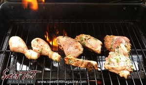 Chicken on grill with fire for Sorrel chicken or roselle red fruit grilled chicken for breakfast, lunch, Christmas season or health benefits for cholesterol, blood pressure, bladder infections, constipation, maylase, use recipe for good taste and health benefits in in Sweet T&T, Sweet TnT, Trinidad and Tobago, Trini, vacation, travel