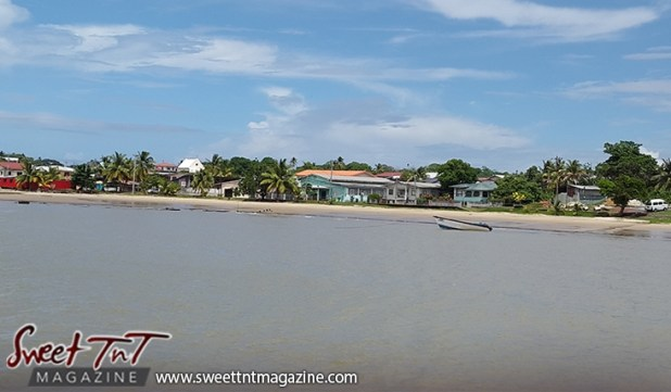 Icacos water shore blue sky houses boat by Marika Mohammed for story Icacos end of Trinidad in Sweet T&T, Sweet TnT, Trinidad and Tobago, Trini, vacation, travel
