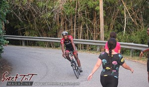 Cyclist and 2 women and man walking exercising on Lady Chancellor Hill Port of Spain for story original outdoor gym in Sweet T&T, Sweet TnT, Trinidad and Tobago, Trini, vacation, travel