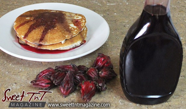 Sorrel or roselle red fruit pancake syrup in a bottle for Christmas season or health benefits for cholesterol, blood pressure, bladder infections, constipation, maylase, use recipe for good taste and health benefits in in Sweet T&T, Sweet TnT, Trinidad and Tobago, Trini, vacation, travel, breakfast