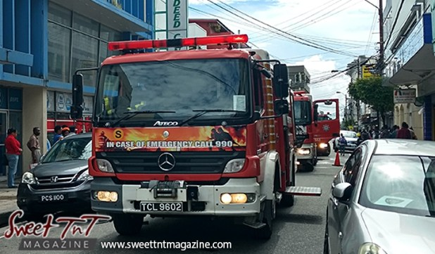 Fire trucks on Henry Street, Port of Spain in sweet T&T for Sweet TnT Magazine, Culturama Publishing Company, for news in Trinidad, in Port of Spain, Trinidad and Tobago, with positive how to photography.
