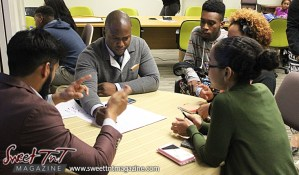 Man makes point to group at table at Launch Rockit business in 54 hours in sweet t&t for Sweet TnT Magazine in Trinidad and Tobago