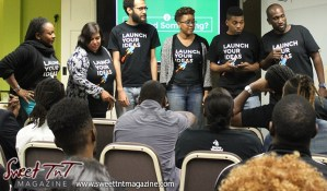 Members wearing Launch Your Ideas t shirts in front audience at Launch Rockit business in 54 hours in sweet t&t for Sweet TnT Magazine in Trinidad and Tobago