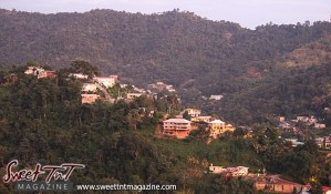 St Ann's view of mountains and houses in city of Port of Spain from Lady Chancellor Hill in sweet t&t for Sweet TnT Magazine in Trinidad and Tobago for tourists, photography, scenic views, vacation, travel
