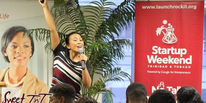 Woman raises hand during presentation of business idea at Launch Rockit business in 54 hours in sweet t&t for Sweet TnT Magazine in Trinidad and Tobago
