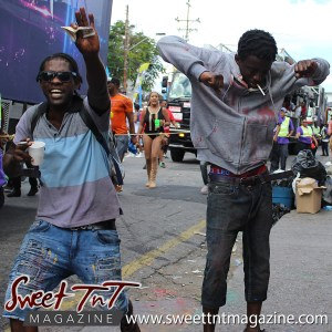 Trinidad and Tobago Carnival Mas men on the pavement on Ariapita Avenue, Carnival 2017 in sweet T&T for Sweet TnT Magazine, Culturama Publishing Company, for news in Trinidad, in Port of Spain, Trinidad and Tobago, with positive how to photography.
