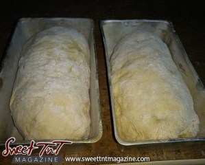 Dough in pan ready to bake bread homemade in sweet T&T for Sweet TnT Magazine, Culturama Publishing Company, for news in Trinidad, in Port of Spain, Trinidad and Tobago, with positive how to photography.