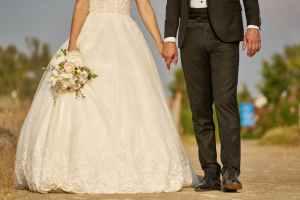 woman wearing white wedding dress and man wearing black suit