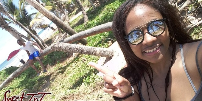 Kerlysse Hilaire at Mayaro Beach takes a selfie with brother Kielon in background.