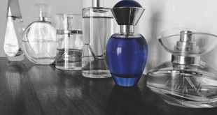 selective focus photography of blue fragrance bottles on table