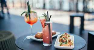 plates with appetizers and cocktails in street restaurant, 6 cannabis treats to enjoy in summer